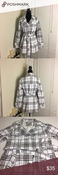 Weather Tamer plaid trench coat White, black and tan plaid trench coat from Weather Tamer. Fully lined, lightweight jacket. Tan and silver buttons, tie waist and silver studs on sleeves and pockets. Weather Tamer Jackets & Coats Trench Coats