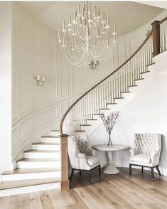 At our first meeting with our darling client we talked about her vision for a curved staircase in the entryway. Love how this turned out!