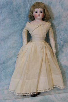 "15"" French bisque poupee/cobalt blue eyes & original poupee fashion body ca.1865 