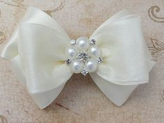 Satin and Pearls Hair Bow Clip from Pink Bowtique - Comes in custom sizes (smaller or larger) and features chiffon covered satin with a pearl cluster center stone.