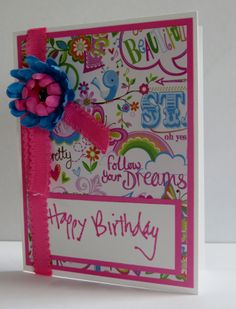 Spring birthday card.  Floral print with pink and blue paper flower.