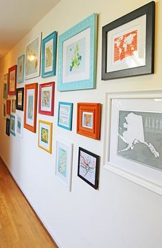 Travel Wall - Buy a map or postcard from each place you visit and frame it. Love the colored frames.