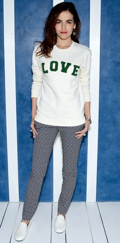"""Camilla Belle celebrated Tory Sport's first store in New York City in an ensemble that fused fashion and sport—she wore a """"Love"""" terry sweatshirt and playfully printed pants styled with a mini satchel, a bangle watch, and white slip-ons, all by Tory Sport."""