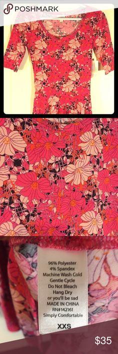 "LLR Nicole Dress Size XXS Soft, lightweight Nicole. Black background with pink ""Hawaiian"" theme flowers. Splashes of orange really make this dress spectacular! Smoke free home. LuLaRoe Dresses Midi"