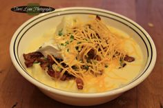 Loaded baked potato soup- Cut and boil potatoes. Next cut bacon in pieces and cook. Add onions to bacon and cook together. Make soup base... 6 cups of milk and a half a cup of flour. Keep stirring and bring to a boil. Add a sprinkle of garlic powder. Also add 2 cups of chicken broth. Final ingredient add 12 ounces of cheddar cheese. Once base is thick add the potatoes. Load your soup with bacon bits, more cheese, sour creme and chives! ENJOY!