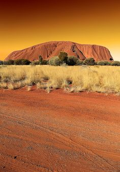 Ayers Rock or Uluru in the red center of Australia. It is a journey to get to Alice Springs from just about any major city, but well worth it. Photo by peo pea, via Flickr