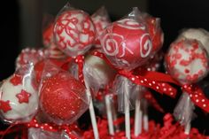 Red filigree Cake Pops By busy bee cupcakery