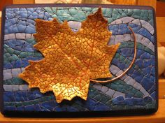 """Eggshell mosaic, the leaf is created of polyclay with eggshell, stem is beaded wire.  Size: 7"""" x 5"""""""