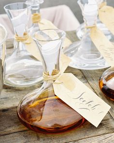 Beautiful decanters tied with calligraphed tags turn liquor into decor