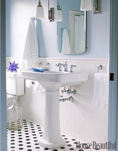 A clean, traditional bathroom. Designed by Newell Turner. housebeautiful.com #classic #bathrooms #pedestal_sink