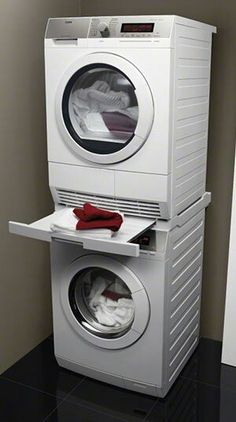 Stacked washer dryer with folding shelf between.  Tiff...can you get this stack section with pull out folding area?