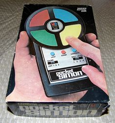Vintage Pocket Simon Handheld Electronic Game by Milton Bradley, Copyright 1980.