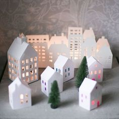 Download template, print and fold into small paper houses which will light up your winter evenings. Tutorial in English and Swedish.