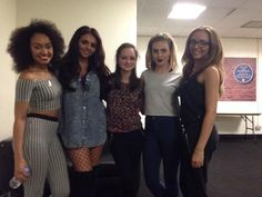 Little Mix. jesy's outfit tho! dont even get me started on leigh and jade's glasses! perrie always looks great! wow!