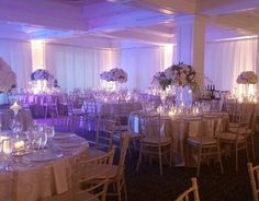 The ambient lighting in this ballroom ties the florals together so nicely!