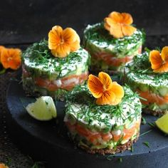 A perfect starter of salmon and avocado on rye bread. (in Norwegian)
