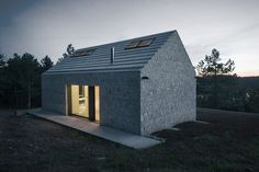 Designed by Dekleva Gregorič Arhitekti this simple-looking house is located in Slovenia and represents a modern take on a traditional cottage.
