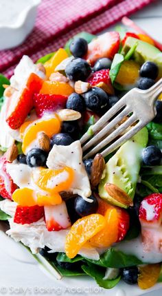 This colorful, healthy strawberry almond chicken salad has the works! Juicy berries, crunchy almonds, creamy avocado, chicken, and homemade poppy seed dressing.