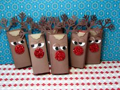 I saw some reindeer candy wrappers for full sized hershey bars on stacystamps.com.  I made some adjustments to make ones to fit with mini kit kat bars.  Instructions on my blog:  http://myhappyplace.typepad.com