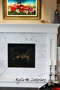 Contemporary or modern style fireplace with white mantel and marble surround
