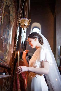 orthodox bride venerating the theotokos. so, so beautiful <3