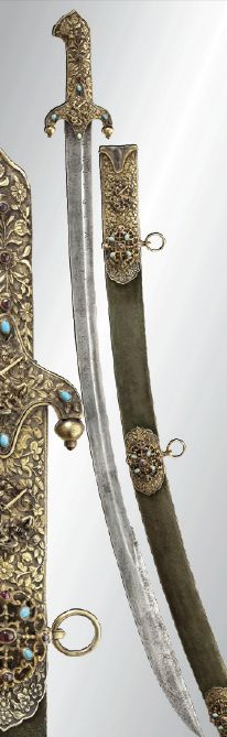 """A sabre for a Hungarian magnate, 19th/20th cent. Single-edged blade (of earlier date) with fullers on either side and broadened, double-edged point. On the obverse side two sickle marks and inscription """"FRINGIA"""" at the base of the blade. Florally chased, gilt silver grip, the obverse with applied image of St. George and set turquoise and garnet cabochons. Velvet-covered wood scabbard with silver fittings set with garnets and turquoises and chased en suite. Length 97.5 cm."""