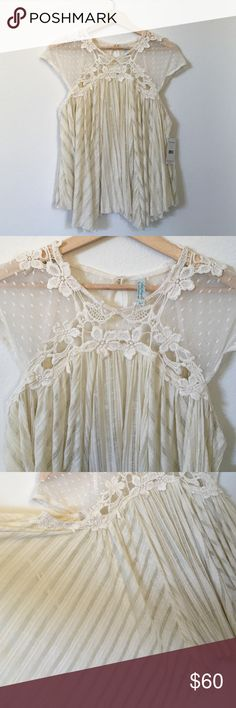 Free People Top Free People Top, flowy, sheer top. Gorgeous top embellishment touches. Please see pictures. In eggshell color. Free People Tops