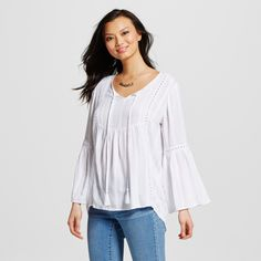 There's something extra soft and lovely about the Women's Textured Woven Folk Top with Tassels and Crochet Trim by August Moon. With emphasis on movement, this women's lace inset peasant blouse is fresh and dynamic.