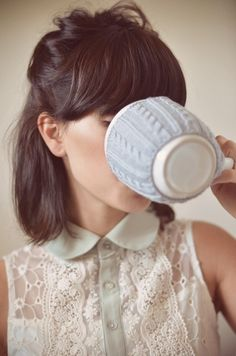 short hair with a fringe :D and I love the sweater on the cup!
