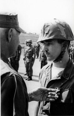 """""""Corpsman receives Navy Cross, Vietnam"""", May 1968 The caption reads """"HM2 Gerald Strode, 21, is decorated with the nation's second highest medal. The Navy Cross was presented to Strode by MajGen Donn J. Robertson, commanding general of the 1st Marine Division. Strode received the award for extraordinary heroism under fire in a battle during Operation Swift, September 4, 1967, when he saved the lives of several wounded Marines."""""""