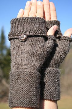 These fingerless mitts feature a stylish fold back flap that bottons. The mitts are worked in the round with sport weight wool.
