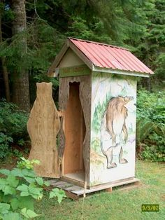 outhouse with a door shaped like a bear