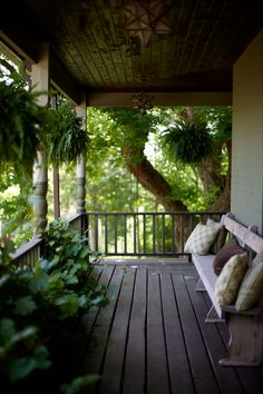 Front porch serenity. Lynne Knowlton's beautiful home - check out the post, they built their pool in a barn foundation!