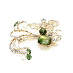Die vergoldete Brosche von Ugo Correani für Valentino ist mit ihrer beeindruckenden Liaison aus funkelnden Kristallsteinen, Perlen und Schmucksteinen in betörendem Jadegrün Luxus mit exklusivem Charakter. Entdeckt wurde das Vintage-Piece aus den späten Siebzigerjahren vom Mailänder Label La DoubleJ.
