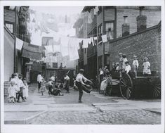 The old days--- kids just hung out on the street :-) Tenement playground, New York (1900-1937) Photo: L.W. Hine