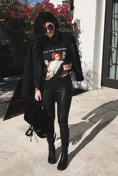 Kylie Jenner wearing  J Brand Leather Pull-On Legging, Vintage 1999 Marilyn Manson Rock is Dead '99 Tour T-shirt, Ann Demeulemeester Zipped Up Ankle Boots, Dior Reflected Sunglasses in Dark Blue, Balenciaga Classic Traveller Suede Backpack, Ports 1961 Andy Warhol Print Biker Jacket