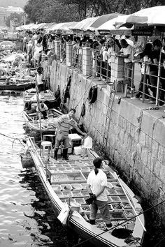 small boats moored along the shore selling live seafood, Sai Kung, Kowloon, Hong Kong
