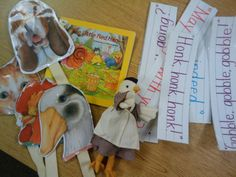 The Little Red Hen play with puppets and sentence strips.