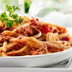 Turkey and mushrooms slash the fat and calories of classic ragu while retaining all of the flavor and richness.