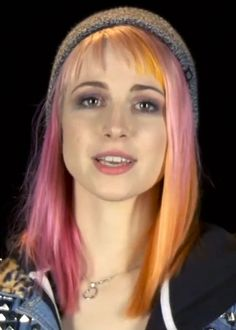 She often parted her hair into the pink side to get strands of pink mixed in with the orange.