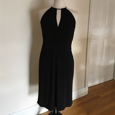 """LOFT Sexy Black Dress NWOT Sz. 6 This is the perfect """"Little Black Dress"""". It is sexy, yet classy and sophisticated. It is made by Ann Taylor Loft. Is new without tags. Zips to close on the side.  The last picture is the back of the dress. Ties to close at the top back.   60% Rayon  40% Polyester LOFT Dresses Midi"""
