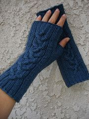 Fingerless mitts for him or her with easy sizing ribs & a beautiful central cable.
