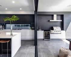 Renovation ideas: 5 ways to make your home cohesive - The Interiors Addict Island bench kitchen to the alfresco, grey granite tiles, White ceiling dark grey wall Indoor Bbq, Indoor Outdoor Living, Outdoor Rooms, Outdoor Dining, Modern Outdoor Living, Outdoor Showers, Outdoor Tiles, Outdoor Patios, Architecture Renovation