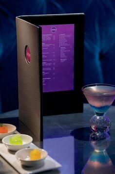 At The Ritz-Carlton Atlanta the lobby bar menu glows fuchsia when opened.
