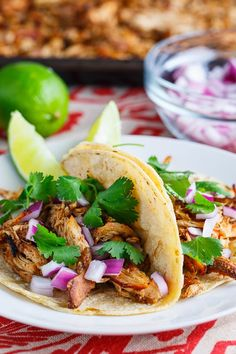 Slow Cooker Chicken Carnitas Tacos...serve over cilantro lime cauliflower rice instead of tortilla