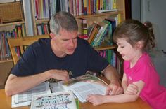 A Sonlight dad reads the Bible with his daughter.reads to her 9- and 11-year-old children
