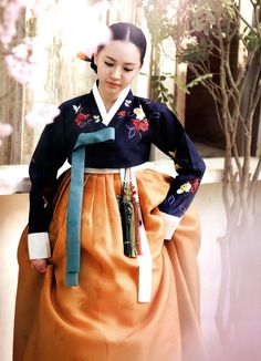 Hanbok./ One of the most famous characteristics of Hanbok is its vivid colors and straight and curved lines. The beauty of hanbok is in its clean, artistic lines and its vibrant colors.