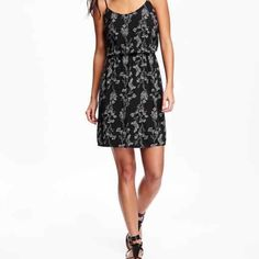 NWT's black floral print cami style dress. NWT's black floral print cami style dress.  Scoop neck; adjustable cami straps. Elasticized waistband. Hits above the knee. Soft medium weight. 100% rayon. Machine washable. Dresses