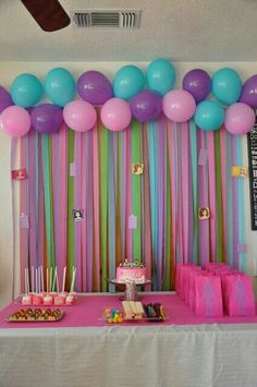 Colourful, love the balloon and crepe paper decoration.