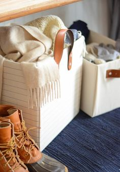 Make This DIY Storage Bin from Old Belts and a Cardboard Box! Iron & Twine - attach leather handles to fabric boxes